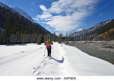 Snowshoe walkers at Rissbach stream, Risstal, Rissbachtal, Karwendel Mountains, Tyrol, Austria - Stock Photo