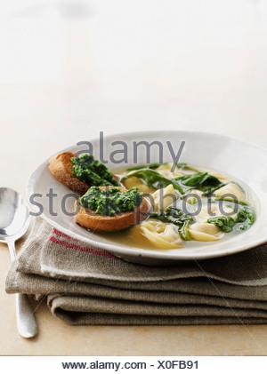 Bowl of ravioli with pesto toast - Stock Photo