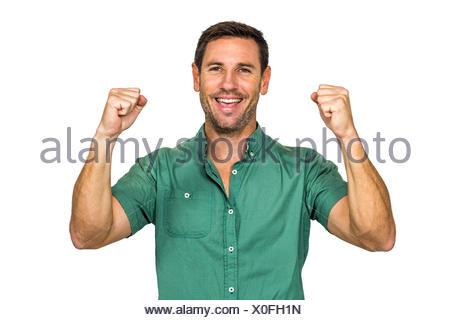 Happy man rejoicing raising fists - Stock Photo