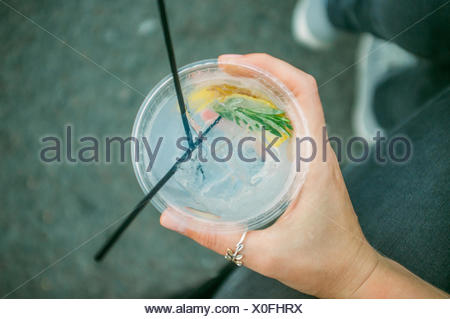 Cropped Image Of Woman Holding Gin Tonic Cocktail - Stock Photo