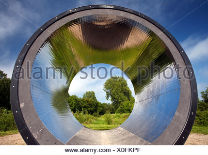 view through the artwork 'Pixelroehre'  ('pixel tube') in a meadow at a forest edge near the mouth of river Koerne, Germany, North Rhine-Westphalia, Ruhr Area, Kamen - Stock Photo