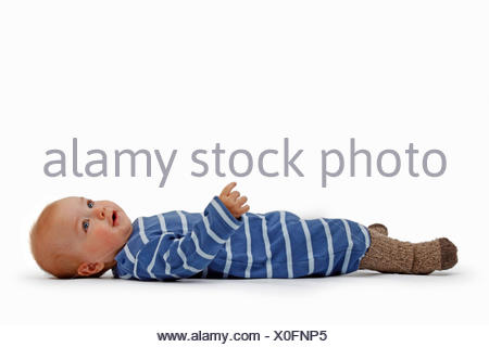 little boy in romper lying at the back - Stock Photo