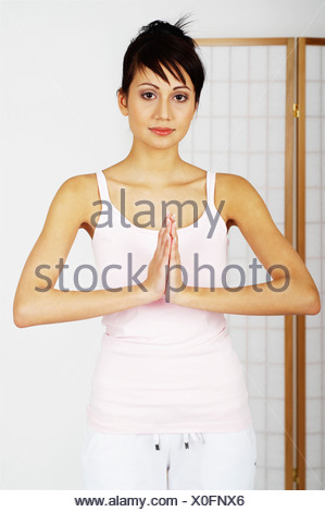 Young woman relaxing, meditating - Stock Photo