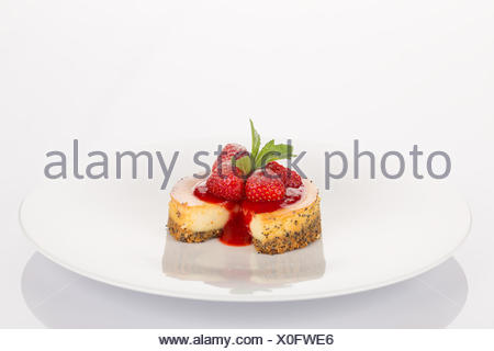 Cheesecake, strawberry, coulis and mint - Stock Photo