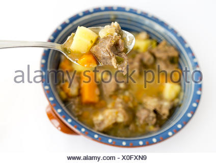 Beef stew in a spoon - Stock Photo