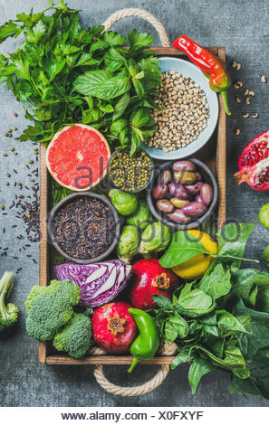 Fresh vegetables and fruits, seeds, cereals, beans, spices, superfoods, herbs, condiment in wooden box for vegan, allergy-friendly, clean eating and r - Stock Photo
