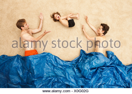 Germany, Artificial beach scene with family having fun in waves - Stock Photo