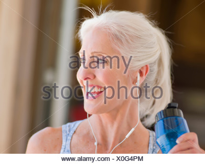 Older woman working out at home - Stock Photo