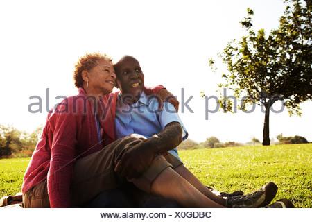 Portrait of senior couple sitting in park