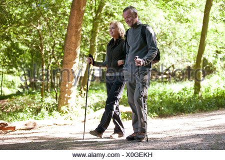 A mature couple walking in the countryside - Stock Photo