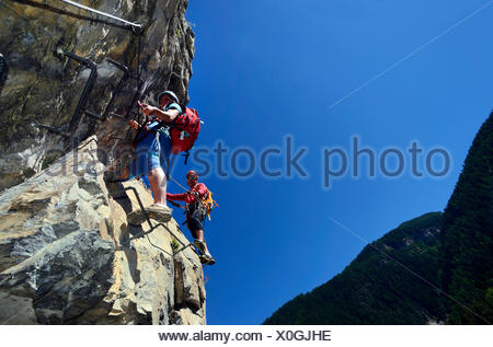 climbers on Via Ferrata du Diable, called The Bridge of Devil, France, Savoie, Aussois - Stock Photo