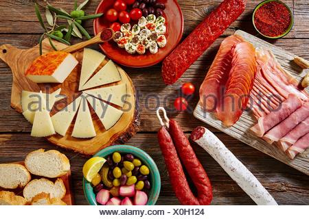 Tapas sausage mix from Spain jamon iberico lomo cheese ham chorizo olives. - Stock Photo