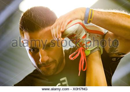 Personal trainer working with woman in gym - Stock Photo