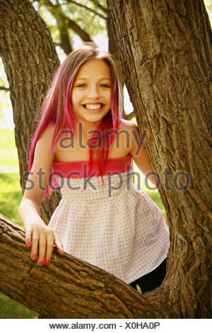 Girl With Pink Hair In A Tree - Stock Photo