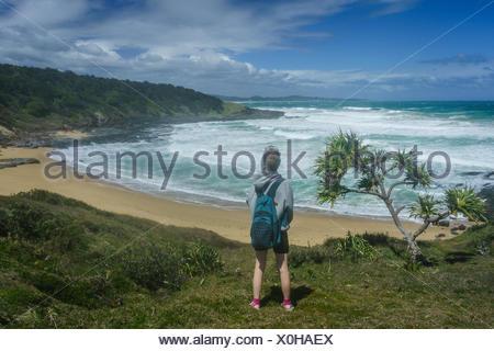 Woman looking at view, Wilson's Headland Walk, Yuraygir National Park, New South Wales, Australia - Stock Photo