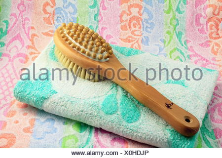 Wooden brush with the handle for massage of a body - Stock Photo