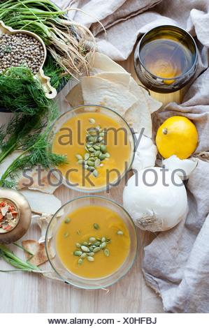 Pumpkin soup seeds onion and lemon - Stock Photo
