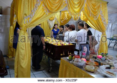 Widow grieving the death of her husband. Sarawakian chinese funeral ceremony. Malaysia