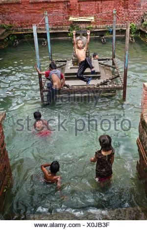 Girls playing in public pool meneffe valley riverside county stock photo 22051076 alamy for Public swimming pools in riverside ca