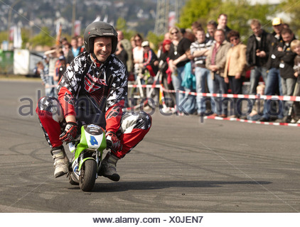 Motorcycle stuntman Mike Auffenberg riding a pocket bike, Koblenz, Rhineland-Palatinate - Stock Photo