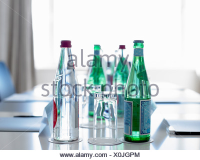 Bottles of water in a conference room - Stock Photo