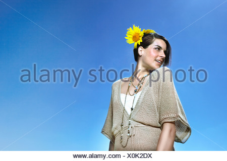 Portrait of a woman against blue sky - Stock Photo