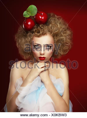 Doll woman with cherries. - Stock Photo