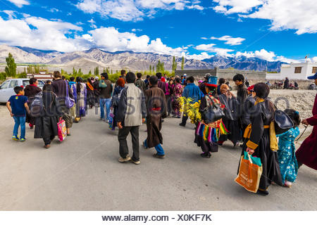 Buddhists walking to attend a teaching by His Holiness the 14th Dalai Lama at Choglamsar, Ladakh, Jammu and Kashmir State, - Stock Photo