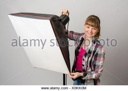 Photographer studio sets the correct direction of light softbox. - Stock Photo