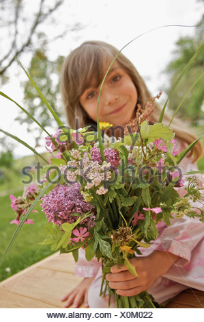 Little girl with a bouquet of flowers - Stock Photo