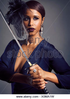 Woman with black veil holding a Katana sword in her hands