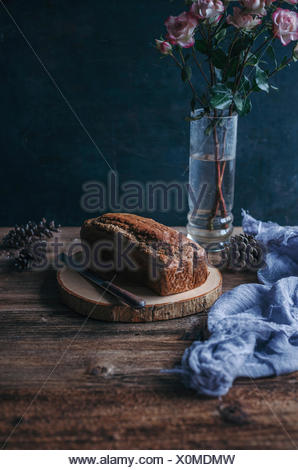 Banana chocolate chip bread on a wooden cutting board - Stock Photo