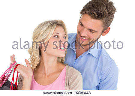 Attractive young couple with shopping bags - Stock Photo