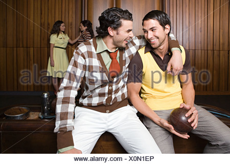 Friends at a bowling alley - Stock Photo