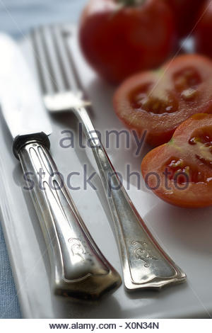 Old silver cutlery (Jugendstil) and Tomatoes - Stock Photo