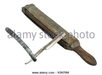 Old (rusty) straight razor with strop isolated on white. - Stock Photo