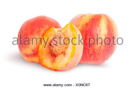 Two whole and half of peach - Stock Photo