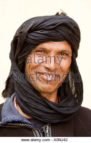 Berber wearing a Djellaba, a traditional robe, near Asni, Morocco, Africa - Stock Photo