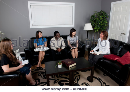 A Group Of People Having A Bible Study - Stock Photo