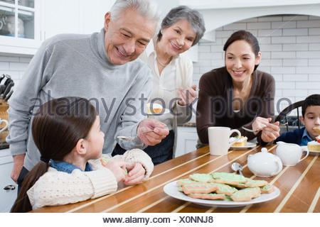 Family in kitchen - Stock Photo