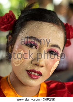 A portrait of a woman with thanaka on her face. - Stock Photo