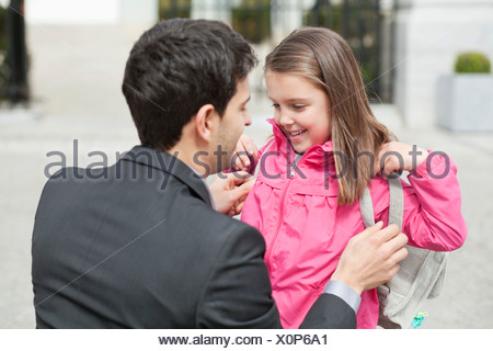 Close-up of a girl with her father - Stock Photo