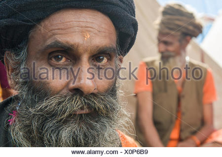 Portrait of a Udaisin Sadhu, holy man, at the Sangam, the confluence of the rivers Ganges, Yamuna and Saraswati - Stock Photo