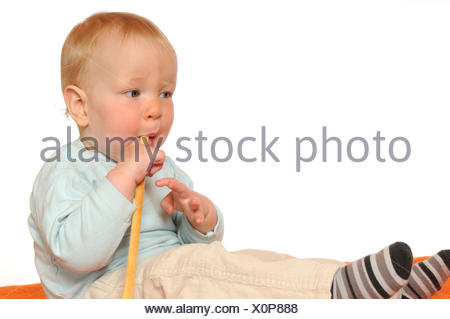 baby, put, sitting, sit, young, younger, eating, eat, eats, nibble, nibbling, - Stock Photo