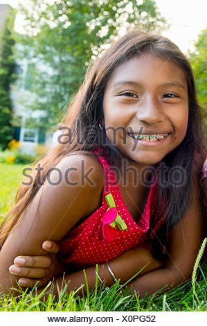 Girl lying on grass - Stock Photo
