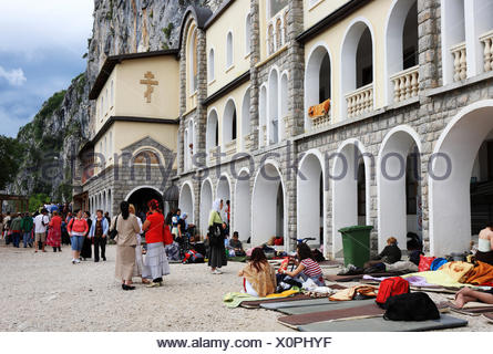 Montenegro, Pilgrims in front of the orthodox convent of Ostrog - Stock Photo