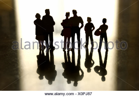 Family group of figures in silhouette - Stock Photo