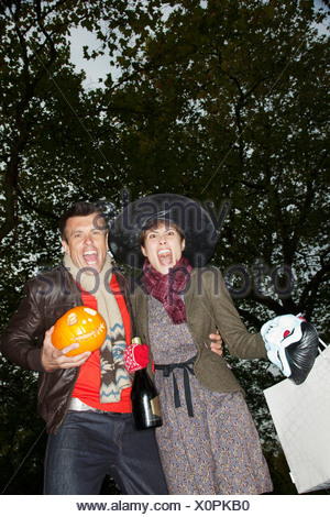 Man and woman going to Halloween party - Stock Photo