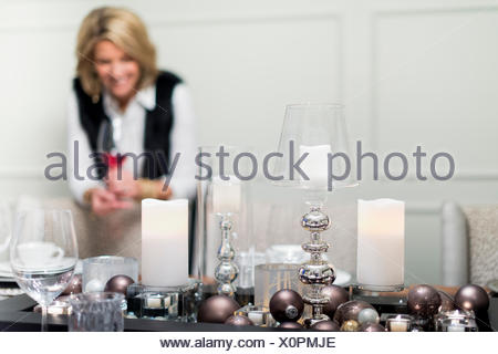 Family together for Christmas in large house with beautiful decorations. - Stock Photo
