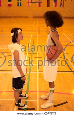 Tall and short basketball players - Stock Photo